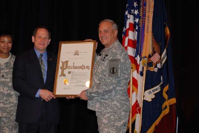 "Mayor Francis Slay (left) proclaimed Monday, Oct. 29, ""Army Strong Day"" in the City of St. Louis, MO. Slay presented the proclamation to GEN William Wallace, Commander, U.S. Army Training and Doctrine Command. GEN Wallace and over 500 other Soldiers gathered in St. Louis recently for the World Wide Retention Training Seminar; an annual event focused on growing and maintaining the most professional fighting force in the world."