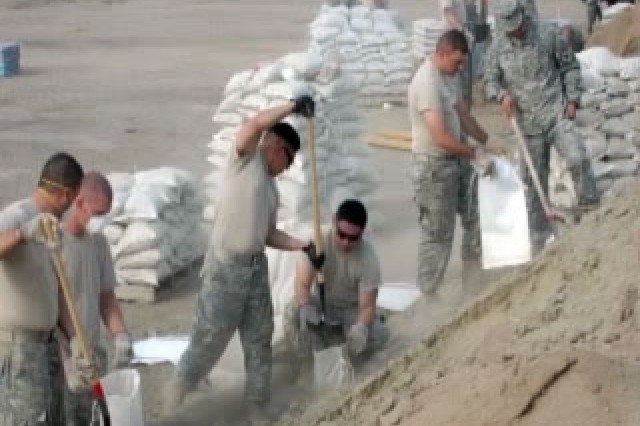 Faced with the possibility of heavy rains causing mudslides and flash floods following the Southern Soldiers fill thousands of sandbags in order to protect lives and property.