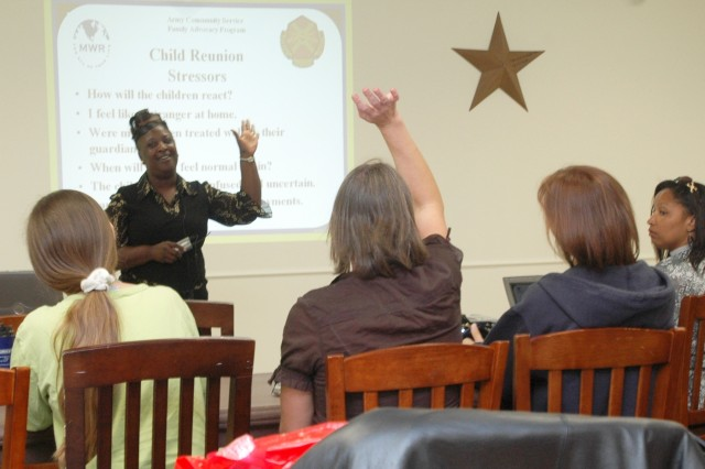 Mary Prater, a representative for the Family Advocacy Program, discusses techniques on how to slowly reintegrate spouses back into daily life at home during a Reunion and Reintegration Training held Oct. 25 at the Oveta Culp Hobby Soldier and Family Readiness Center on Fort Hood, Texas.
