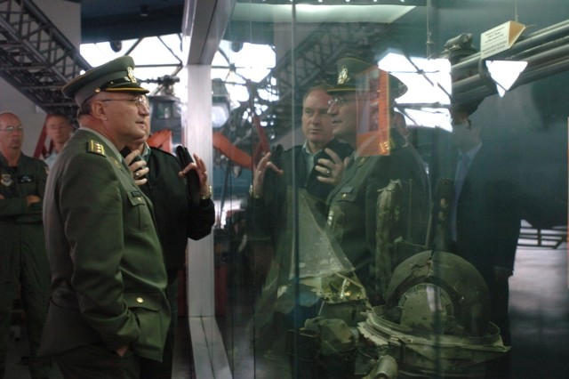 "Maj. Gen. Gregory L. Wayt, Ohio adjutant general (reflected on left), discusses the wreckage of a U.S. Air Force F-16 ""Fighting Falcon"" that crashed in northwest Serbia in 1999, with Col. Petar Cornakov, a member of the Serbian general staff, during a Sept. 19, 2007, tour of the Serbian Air Force museum in Belgrade. Maj. Gen. Wayt and a delegation of about 40 Ohio troops visited Belgrade and Nis as part of the State Partnership Program. The visit was the largest such exchange since the partnership began just over one year ago."