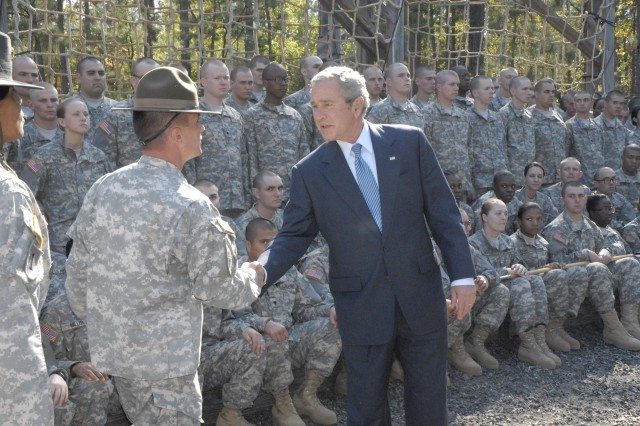 President George W. Bush greets drill sergeants and first-day Basic Combat Training Soldiers at Fort Jackson's Fit 2 Win course Friday.