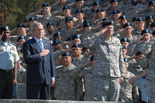 President George W. Bush and Brig. Gen. James H. Schwitters, Fort Jackson commanding general, pay respect during the National Anthem at graduation Friday.
