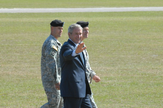 President George W. Bush, leaves Fort Jackson's graduation ceremony Friday with Brig. Gen. James H. Schwitters, Fort Jackson commanding general, and Command Sgt. Maj. Brian A. Carlson, Fort Jackson command sergeant major, behind.