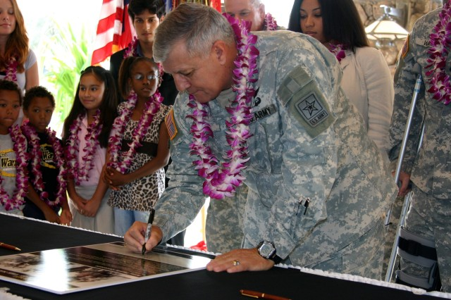 Gen. Richard Cody, Army Vice Chief of Staff, signs the Army Family Covenant during a ceremony held at Schofield Barracks, Nov. 1.
