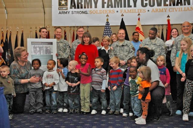 Military leaders and Family members celebrate the signing of the Army Family Covenant for the U.S. Army Garrison Wiesbaden Oct. 30 at the Community Activity Center on Wiesbaden Army Airfield