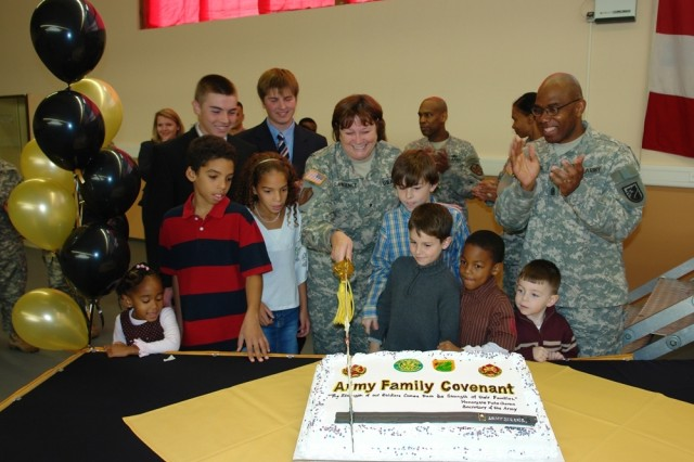MANNHEIM, Germany - The Army community of Mannheim, Germany, joined the worldwide Army Family Covenant program with a Nov. 2 signing ceremony that included Brig. Gen. Susan Lawrence, commander of 5th Signal Command, cutting a cake for attendees. Other community leaders participating were: Lt. Col. Jeffrey Fletcher, U.S. Army Garrison commander, 5th Signal Command Sgt. Maj. Roderick Johnson and USAG Mannheim Command Sgt. Maj. June Seay.