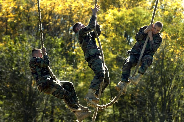 Cadets participate in the rope climb challenge.