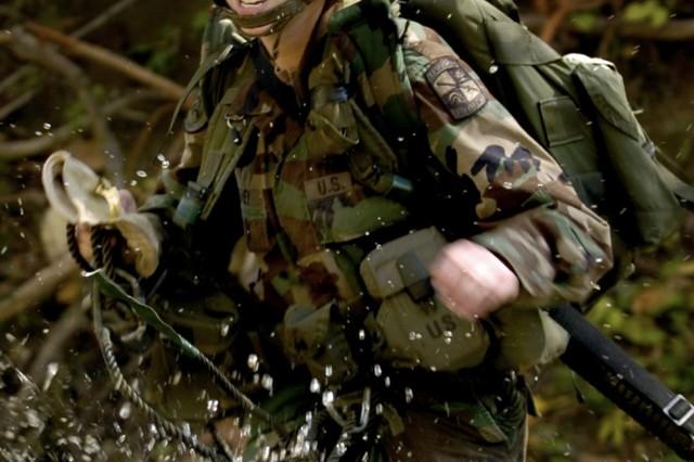 Cadet Erin Fahey fords a stream.