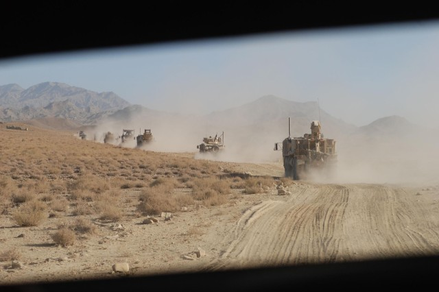 A driver sees a trail of dust ahead.