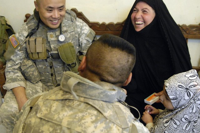 Dr. (Maj.) Henry Shih shares a laugh with his patients.