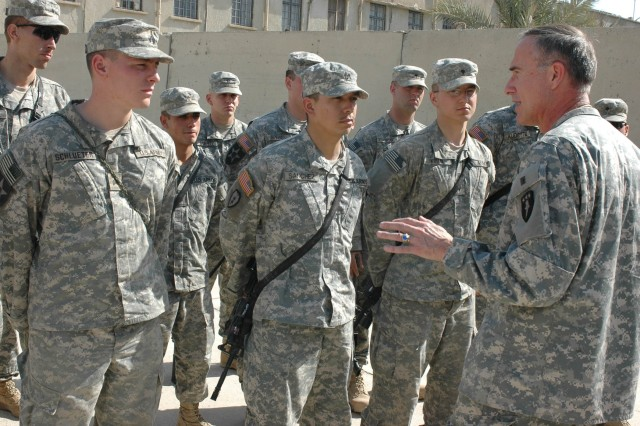 Maj. Gen. David H. Huntoon Jr., commandant of the U.S. Army War College in Carlisle, Penn., thanks the Soldiers of his son's platoon, Company B, 1st Battalion, 38th Infantry Regiment, 4th Stryker Brigade Combat Team, 2nd Infantry Division, before promoting his son from first lieutenant to captain at Diyala's Government Center in Baqouba, Iraq, Nov. 2.
