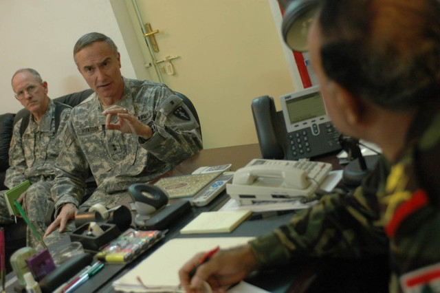 Maj. Gen. David H. Huntoon Jr., commandant of the U.S. Army War College in Carlisle, Penn., speaks with Staff Maj. Gen. Abdul Kareem, commander of Iraqi Security Forces in Diyala province, Iraq, while receiving an update on the Diyala Operations Center in Baqouba, Iraq, Nov. 2. Huntoon's visit was focused on lessons learned in Diyala province, as well as promoting his son, a Soldier with 1st Battalion, 38th Infantry Regiment, 4th Stryker Brigade Combat Team, 2nd Infantry Division.