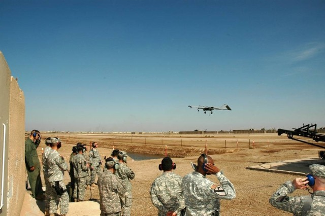 Portola Valley, Calif., native Maj. Gen. Joseph F. Fil Jr., the commanding general of the 1st Cavalry Division and Multi-National Division-Baghdad, (center-left, with controller) launches an unmanned aerial vehicle at the 1st Air Cavalry Brigade's UAV launch site in Camp Taji, Iraq, Nov. 1.