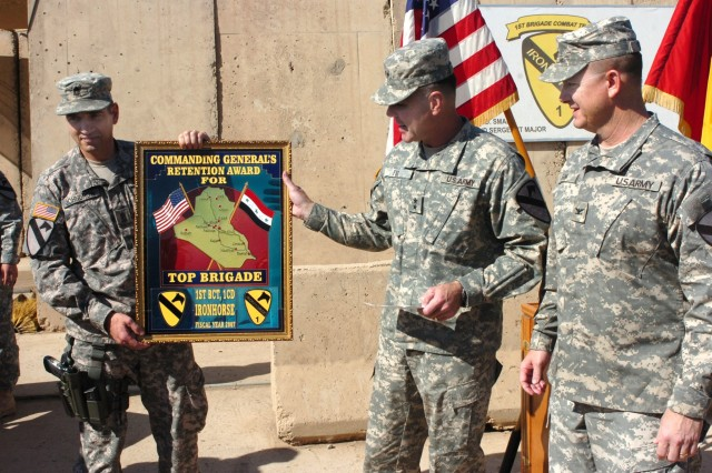 "Maj. Gen. Joseph F. Fil (second from right), commanding general, Multi-National Division-Baghdad and 1st Cavalry Division, and Command Sgt. Maj. Philip F. Johndrow (left), MND-B command sergeant major, present the 1st Cavalry Division's top brigade for retention award to Col. Paul E. Funk II, commander, 1st ""Ironhorse"" Brigade Combat Team, 1st Cav. Div during a ceremony on Camp Taji, Iraq Nov.1. In Fiscal Year 2007, the Ironhorse Brigade accomplished 169 percent of its mission with 1,011 reenlistments."