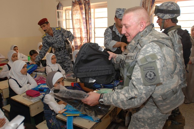 U.S. Army Europe Stryker Soldiers Join with Iraqi Police, Government Officials for Schools Upgrades