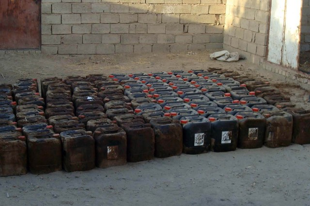 Eight hundred gallons of nitric acid were discovered in southwest Baghdad Oct. 30. The materials would likely have been used to make homemade explosives. (U.S. Army Courtesy Photo)