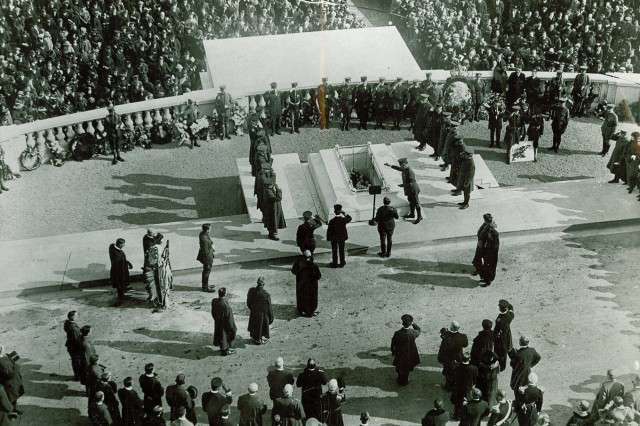 The remains of the Unknown Soldier is committed to the ground during the burial services at Arlington National Cemetery, Arlington, VA  November 11 1921. (WW1 Signal Corps Collection).