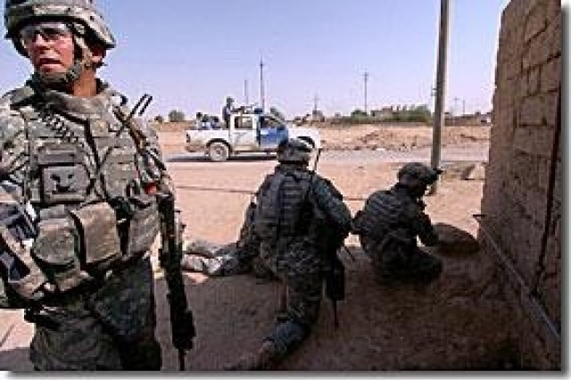 Combined forces fight to secure Iraqi town