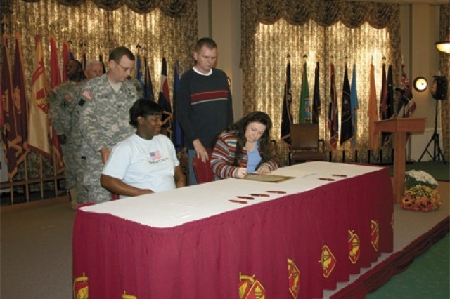 Family Members sign Army Family Covenant