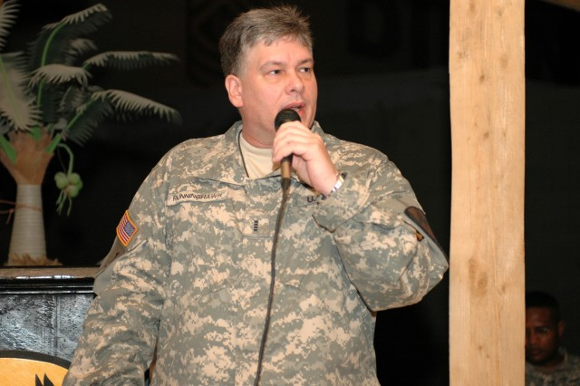 """Abilene, Texas, native Chief Warrant Officer 4 Rick Runninghawk, the tactical operations officer for the 1st Air Cavalry Brigade """"Warriors,"""" 1st Cavalry Division, speaks to troopers about his Cherokee roots and American Indian history during the National American Indian Heritage Month ceremony at Camp Taji, Iraq, Nov. 3. """"We care about our great nation, the United States of America, as much as anyone else,"""" Runninghawk proudly proclaimed about American Indians."""