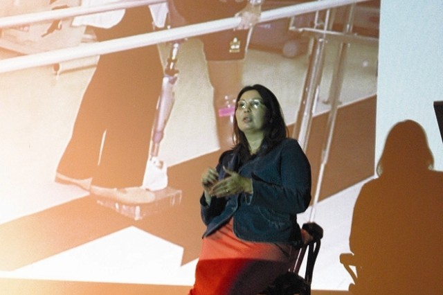 Maj. Tammy Duckworth, who lost both legs in Iraq after her helicopter was attacked in 2004, speaks at the National Disability Employment Awareness Month event Oct. 31 at the Patrick Henry Village Theater.