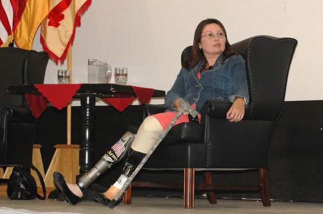 Maj. Tammy Duckworth waits during her introduction to speak to a crowd of USAG Heidelberg employees in PHV Theater Oct. 31.