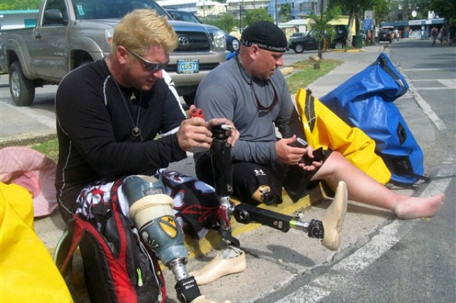 Kevin Pannell (left) works on Andrew Butterworth's broken prosthetic leg in Cruz Bay, St. John, U.S. Virgin Islands on Oct. 21. The two former Soldiers, who both lost legs serving in Iraq, were part of a small group of wounded veterans on a paddling trip to the island.