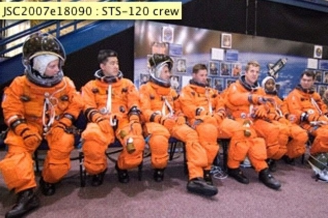 The astronauts are attired in their training suits, preparing for the mission.