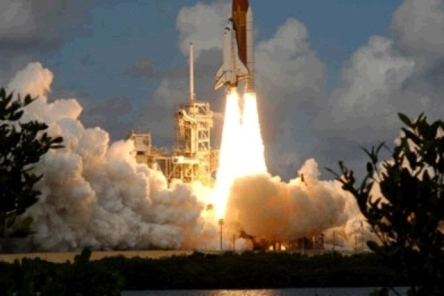 Discovery lifts off from the Kennedy Space Center's launch pad at 11:38 a.m. Oct 23.