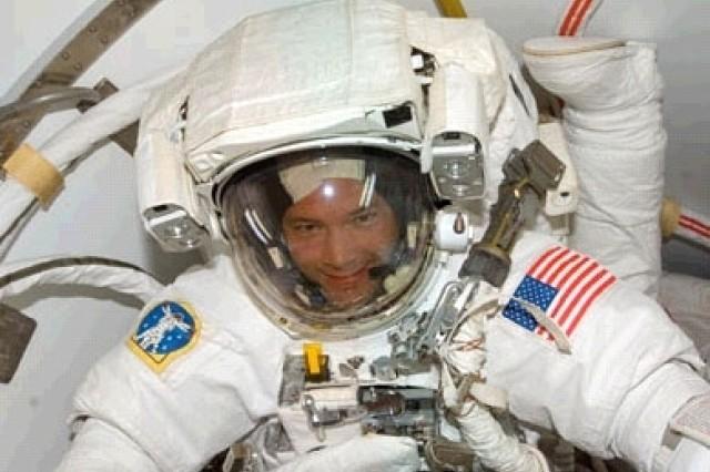 Col. Doug Wheelock prepares for the Oct. 26 spacewalk.