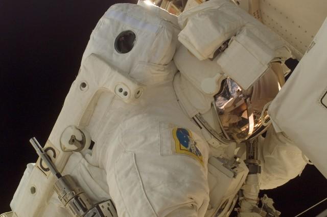 Col. Doug Wheelock participates in the first spacewalk.