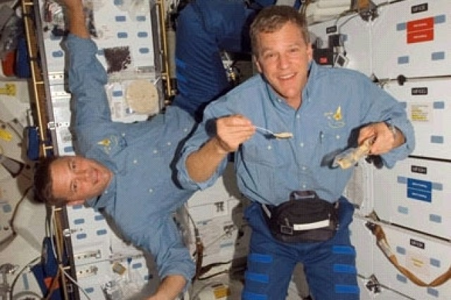 Space walkers Col. Doug Wheelock (left) and Scott Parazynski hover near the galley Oct. 29.
