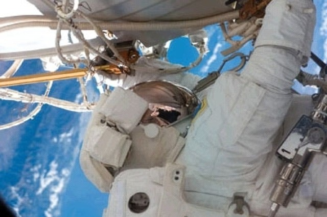 Col. Doug Wheelock installs a truss segment with its set of solar arrays during the mission's third spacewalk.