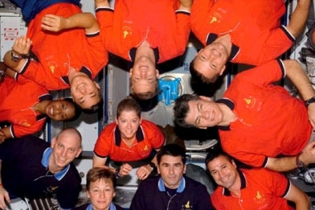 STS-120 and Expedition 16 crewmembers pose for a group photo on Halloween day.