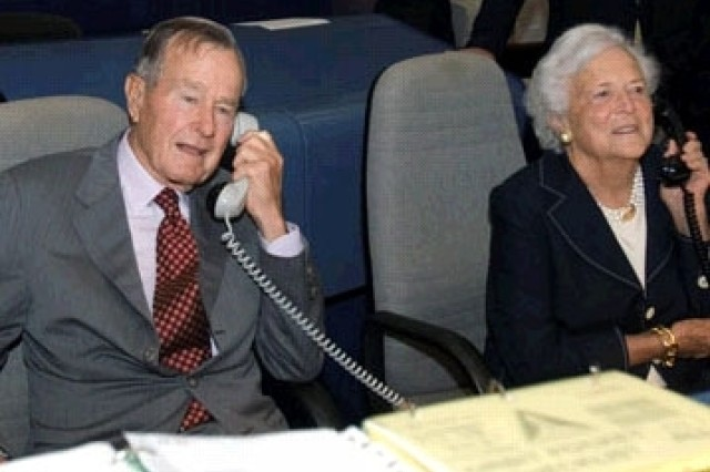 Former President George H.W. Bush and former First Lady Barbara Bush talk to the crewmembers from Mission Control in Houston.