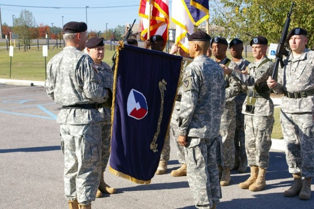 The new colors of the Army Reserve Sustainment Command's Troop Program Unit are unfurled as the Army Materiel Command Commander Gen. Benjamin Griffin (left) and the TPU commander, Brig. Gen. Gary Bunch (center) watches.  The flag uncasing ceremony was held Nov. 3 in Birmingham, Ala.""