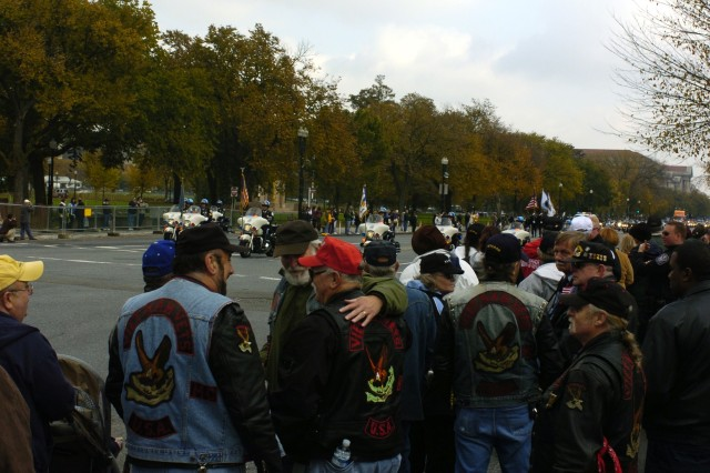 A group of Vietnam veterans greet each other during the parade commemorating 25th anniversary of the Vietnam Veterans Memorial in Washington DC, Nov 10.