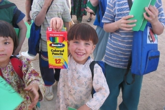 Children at an Afghan orphanage display school supplies from Operation Dreamseed. Operation Dreamseed has distributed hundreds of tons of school supplies to children in Afghanistan, Iraq and Kosovo and helped build a school outside of Kandahar City by raising over $80,000. Maj. Todd Schmidt received the Microsoft Above and Beyond Everyday Difference Award for his efforts.