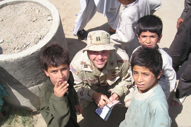 Maj. (then-Capt.) Todd Schmidt poses with Afghan boys during a school-supply distribution event. The grassroots effort quickly became Operation Dreamseed, which has distributed hundreds of tons of school supplies to children in Afghanistan, Iraq and Kosovo and helped build a school outside of Kandahar City by raising over $80,000. Maj. Schmidt received the Microsoft Above and Beyond Everyday Difference Award for his efforts.