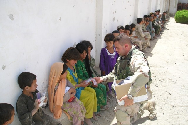 Maj. (then-Capt.) Todd Schmidt distributes school supplies to children in Afghanistan. The grassroots effort quickly became Operation Dreamseed, which has distributed hundreds of tons of school supplies to children in Afghanistan, Iraq and Kosovo and helped build a school outside of Kandahar City by raising over $80,000. Maj. Schmidt received the Microsoft Above and Beyond Everyday Difference Award for his efforts.