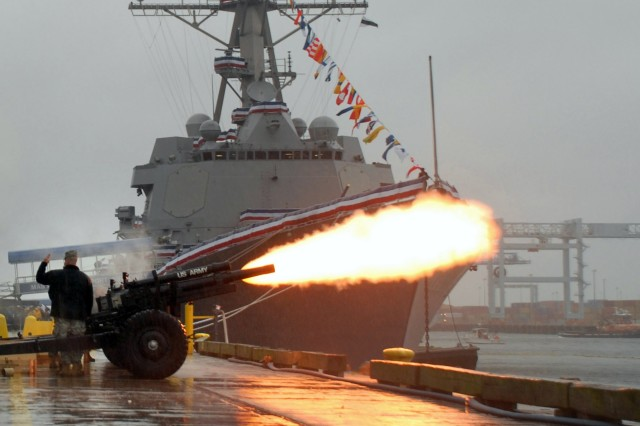 Soldiers from the Massachusetts Army National Guard provide the gun salute for the commissioning of the USS Sampson (DDG 102) in Boston, Nov. 3.