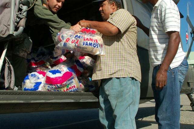 Soldiers Deliver Food, Medicine After Tropical Storm Noel