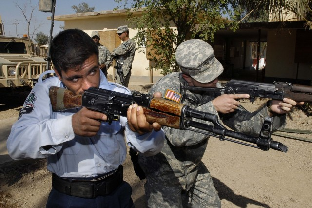 A Soldier practices sight alignment and sight picture with his rifle.