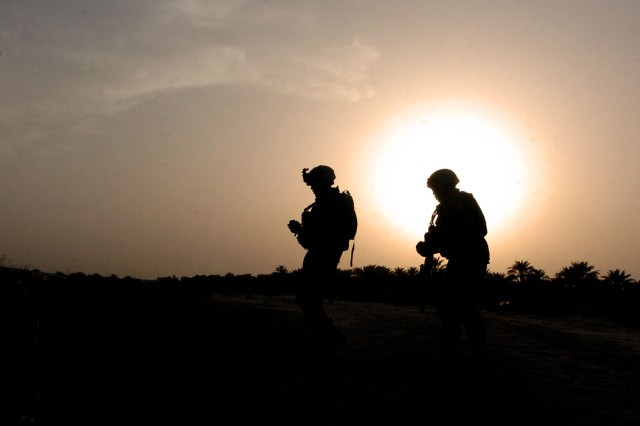 Soldiers from the 2nd Infantry Division patrol Taji, Iraq. Some Soldiers will develop post-combat stress and Post Traumatic Stress Disorder following their deployments. The Army is trying to detect mental health problems while they are still small, simple and temporary.