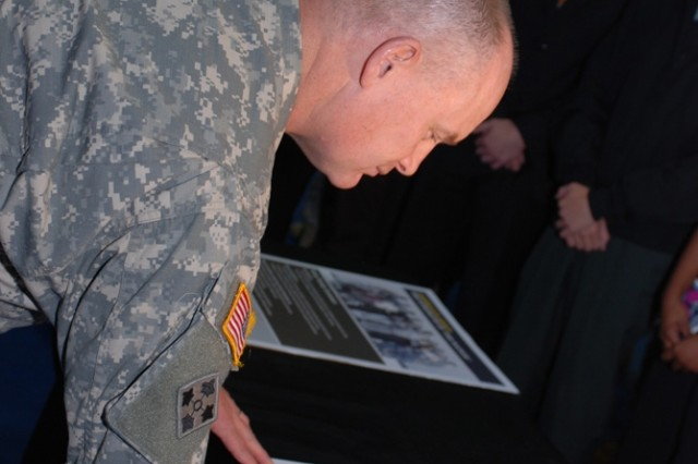 Brig. Gen. David Hogg signs the Army Family Covenant at a USAG Grafenwoehr ceremony Nov. 5 in the Vilseck Memorial Fitness Center.