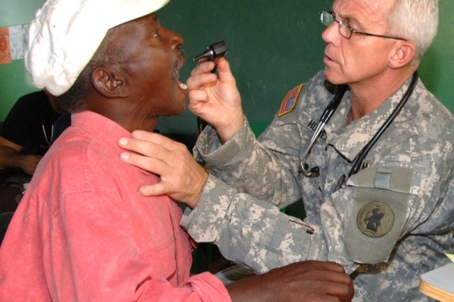 Lt. Col. (Dr.) Michael Hoilien examines a Dominican man at a clinic set up by U.S. servicemembers from Joint Task Force-Bravo Nov. 10, following Tropical Storm Noel.