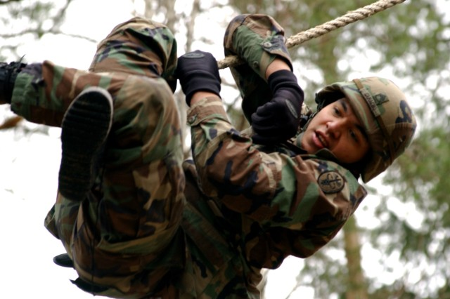 """Staff Sgt. Gabriel Camacho slides down the inverted rope on the obstacle course at the Grafenwoehr (Germany) Training Area while competing for the title of Europe Regional Medical Command NCO of the Year in February. Camacho took on the same course Nov. 4-6 as part of the Expert Field Medical Competition that earned him the title of U.S. Army Europe's """"Top Medic"""" for 2008."""
