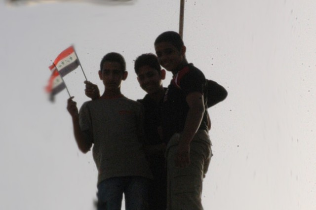 Iraqi boys from the Taji area of northwestern Baghdad stand atop the roof of the Sheik Support Center Nov. 8. The boys observed and listened to local tribal, government and military leaders discuss security, economic and essential service issues during the Northwest Baghdad Regional Summit.