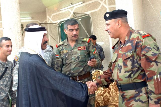 A local tribal leader and an Iraqi Army leader greet each other at the Northwest Baghdad Regional Summit near Taji, Iraq Nov. 8.