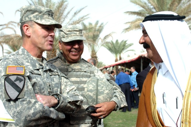 Maj. Gen. Joseph F. Fil Jr., commanding general of the Multi-National Division-Baghdad and 1st Cavalry Division, speaks to a local tribal sheik about the new step of establishing Iraq's self-sustainment during the Northwest Baghdad Regional Summit near Taji, Iraq Nov. 8